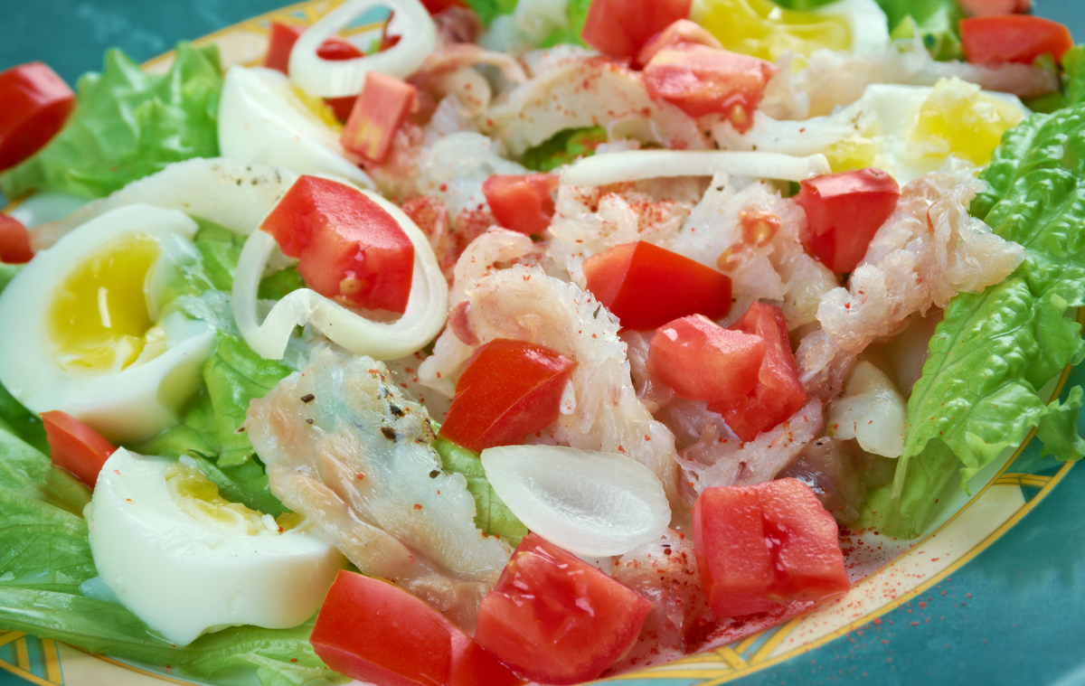 Bacalao Salad with lettuce tomatoes, onions and hard boiled egg
