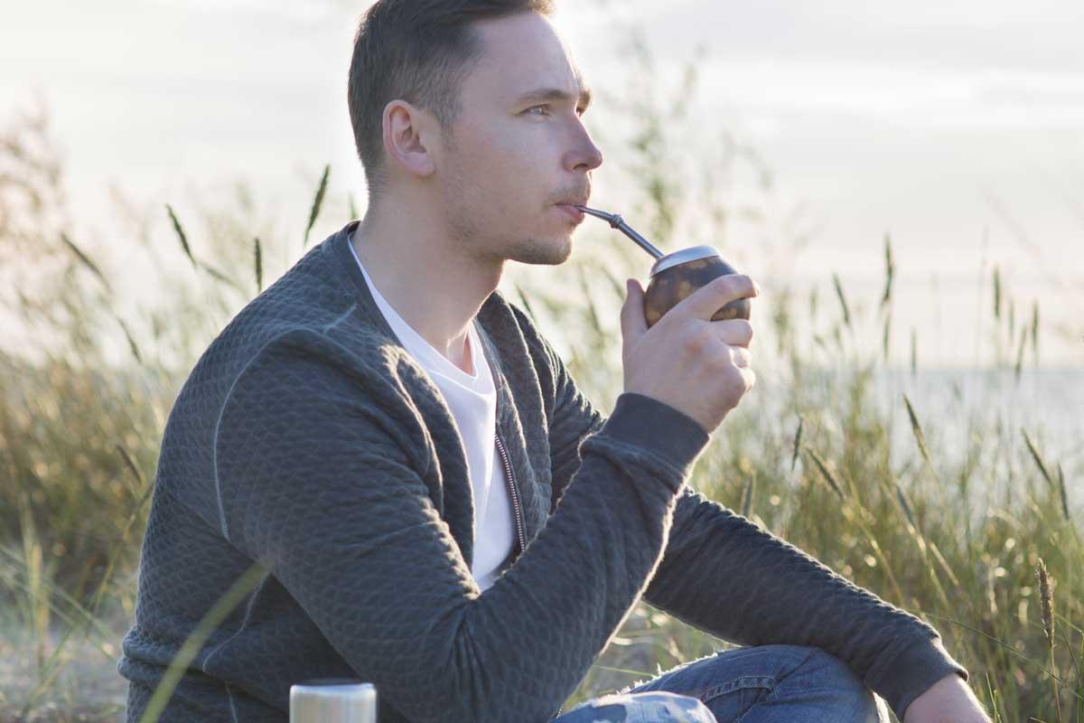Man drinking yerba mate outdoors